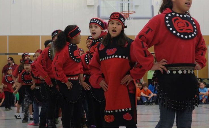 Students from the Harborview Elementary School Tlingit Language and Culture Classroom danced at the Auke Bay school celebration. (Photo by Annie Bartholomew/KTOO)
