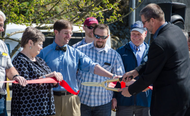 Kirby Day, director of shore operations for Princess Cruises, cuts the ribbon. (Photo by Heather Bryant/KTOO)
