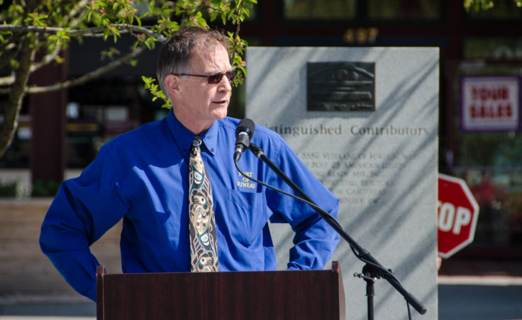 Port Director Carl Uchytil introduces guests at the ribbon cutting ceremony at the cruiseship terminal staging area. (Photo by Heather Bryant/KTOO)