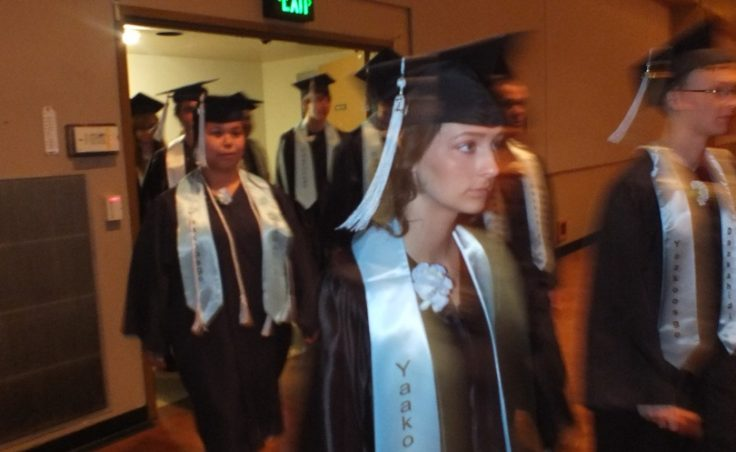 Members of Yaakoosgé Daakahídi Alternative High School graduating class file into Centennial Hall for the 2014 commencement ceremony, May 25, 2014. Nearly 40 YDHS students earned diplomas this school year. (Photo by Casey Kelly/KTOO)