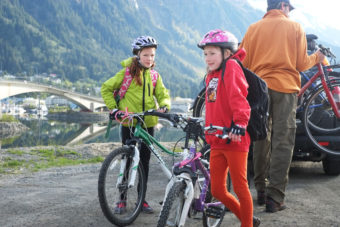 Elementary school students meet at the Douglas Island Breeze In before biking to Gastineau School for Bike to School Day on May 7, 2014. (Photo by Annie Bartholomew/KTOO)