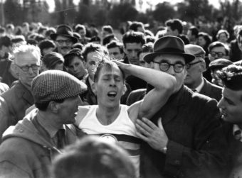 English athlete Roger Bannister among a crowd at Oxford after becoming the first person in the world to run a mile in under 4 minutes (3:59.4). Norman Potter/Getty Images