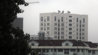The building housing China's Unit 61398, a division of the army linked to hacking operations, is seen in Shanghai last year. The U.S. says the group worked to steal trade secrets from American companies. AP