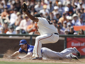 New York Mets' Daniel Murphy slides to score in a game against San Francisco on Sunday. Murphy, who spoke at a White House discussion on Monday, was heavily criticized earlier this year for missing the first two games of the season to be on hand for the birth of his son. Ben Margot/AP