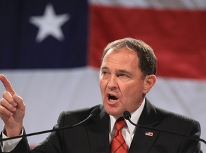 Utah Gov. Gary Herbert addresses a crowd during a rally at the Western Republican Leadership Conference in Sandy, Utah, in April. Herbert reiterated his support of the state's same-sex marriage ban, which was struck down Wednesday by a federal panel. Rick Bowmer/AP