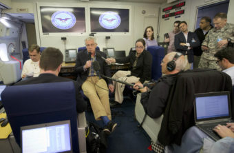 Defense Secretary Chuck Hagel, center, speaks to members of the media aboard a U.S. military aircraft on Sunday. Hagel said quick action was necessary to save Sgt. Bowe Bergdahl's life, leaving no time to disclose the administration's plans to Congress. Pablo Martinez Monsivais/AP
