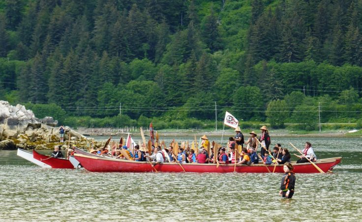 The paddlers gather off the beach. (Photo by Ed Schoenfeld/CoastAlaska News)