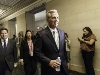 Kevin McCarthy of Calif. arrives with his GOP House allies for leadership elections on Thursday. McCarthy won his bid to replace outgoing Rep. Eric Cantor as the party's majority leader. J. Scott Applewhite/AP