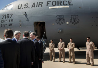 """Secretary of State John Kerry, second from left, arrives at Irbil International Airport with U.S. Ambassador to Iraq Robert Stephen Beecroft, fourth from left, Tuesday. The president of Iraq's ethnic Kurdish region declared Tuesday that """"We are facing a new reality and a new Iraq."""" Brendan Smialowski/AP"""