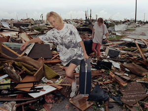 "In 1992, Hurricane Andrew destroyed more than 25,000 homes in Florida. But its death toll was far less than ""female"" storms such as Audrey, Camille and Katrina. Lynn Sladky/AP"