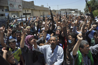Mourners chant slogans against the al-Qaida breakaway group Islamic State of Iraq and Syria after they buried 15 bodies in the village of Taza Khormato in the northern oil-rich city of Kirkuk, Iraq on Monday. Emad Matti/AP