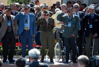 "World War II veterans salute as ""Taps"" is played at a ceremony at the Normandy American Cemetery marking the 70th anniversary of D-Day, June 6, 2014, in Colleville-sur-Mer, France. Win McNamee/Getty Images"