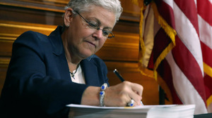 EPA Administrator Gina McCarthy signs new regulations targeting greenhouse gas emissions on Monday. Chip Somodevilla/Getty Images