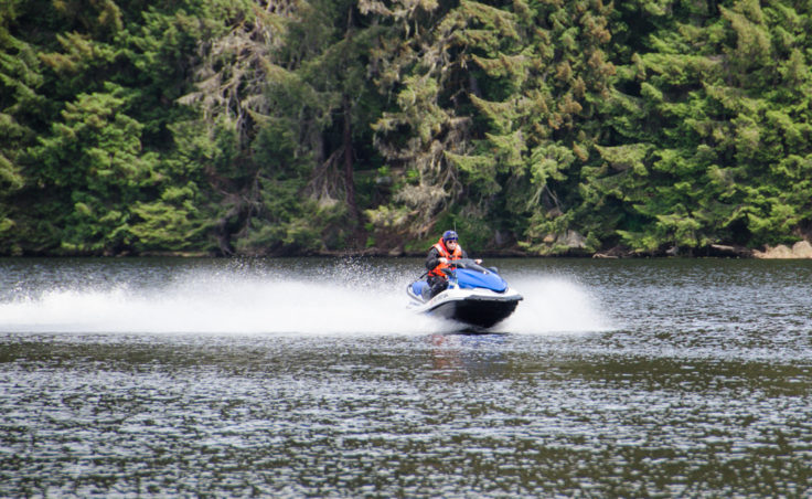 Coast Guard Recreational Boating Safety Specialist Mike Folkerts practices at Auke Lake. (Photo by Heather Bryant/KTOO)