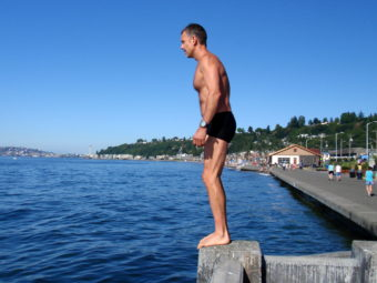 Swimmer Wayne Kinslow prepares to dive into Puget Sound at Alki Beach, a place he personally paid to have tested for traces of Fukushima radiation. (Photo by Tom Banse/NNN)