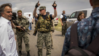 Pro-Russian rebels move journalists away from Malaysian investigators and monitors from the Organization for Security and Cooperation in Europe Tuesday. Malaysia Airlines flight MH17 was allegedly shot down by a missile Thursday; today, U.S. intelligence says it has verified that two rebel leaders spoke by phone about shooting the plane down. Rob Stothard/Getty Images