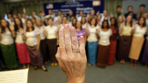 In this 2011 photo, more than 100 Peace Corps volunteers are sworn in before heading to villages in southern Cambodia. Heng Sinith/AP