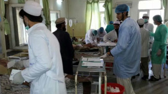 Afghan doctors assist civilians wounded by a suicide bomber in Paktika province on Tuesday. Uncredited/AP