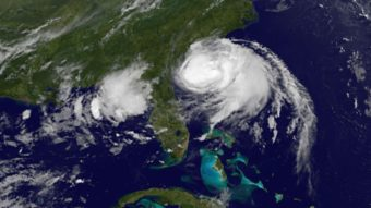 Hurricane Arthur is moving up along the eastern U.S. coast, bringing complications to July 4 travel and holiday plans. A satellite image shows the storm's position at 5 a.m. ET. NASA GOES Project