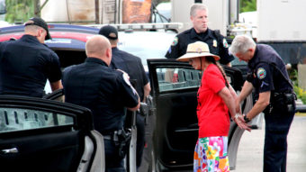 Jane Palmer of Monkton, Vt., was arrested after refusing to leave the Vermont Gas Systems headquarters in South Burlington on Wednesday. She and four other women were knitting in protest of a planned pipeline. Taylor Dobbs/Vermont Public Radio