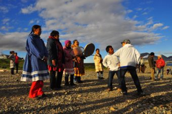 The residents of Novoye Chaplino greeted vistors when they arrived on the beach with traditional song and dance. (Photo by Emily Schwing/KUAC)