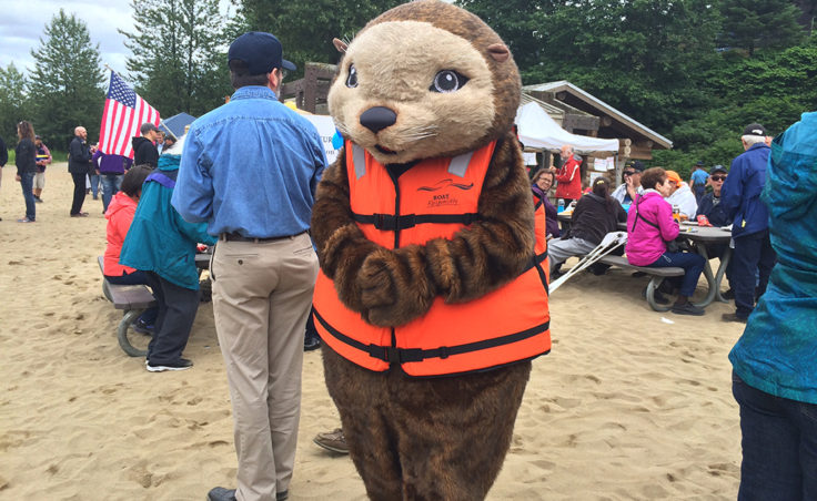 The PFD Otter teaches boat safety at the picnic. (Photo by Sarah Yu/KTOO)