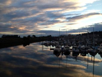 """A July sunset from the Sea Walk """"spur"""" on Crescent Harbor. The city's insurer requires a guardrail to be built here. Photo courtesy KCAW/Shaleece Haas)"""