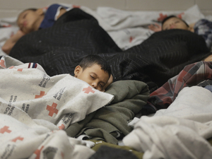 Detainees sleep in a holding cell at a U.S. Customs and Border Protection processing facility in Brownsville, Texas, on June 18. The White House on Tuesday sought $3.7 billion to deal with the immigration crisis at the border. Eric Gay/AP