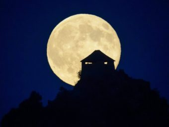 The full moon rises above the castle of Somoskoujfalu, northeast of Budapest, Hungary, earlier this month. Peter Komka/AP