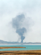 Smoke rises during airstrikes targeting Islamic State militants at the Mosul Dam outside Mosul, Iraq, on Monday. Kurdish forces say they have retaken the dam, but the militants insist they still have control. Khalid Mohammed/AP