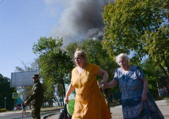 Women rush across the street after shelling in the town of Donetsk, Ukraine on Wednesday. Mstislav Chernov/AP