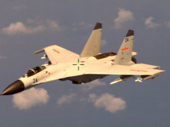 """This handout photo provided by the Office of the Defense Secretary (OSD), taken Aug. 19, 2014, shows a Chinese fighter jet that the White House said Friday conducted a """"dangerous intercept"""" of a U.S. Navy surveillance and reconnaissance aircraft. Uncredited/AP"""