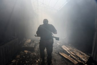 A Pro-Russian rebel walks in a passage at the local market damaged by shelling in Petrovskiy district in the eastern Ukrainian town of Donetsk. Mstislav Chernov/AP