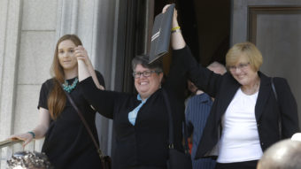 Plantiffs in the federal suit over Virginia's ban on gay marriage, Emily Schall-Townley (from left), Carol Schall and Mary Townley, after a hearing on Virginia's same-sex-marriage ban in Richmond, Va., in May. Wednesday, the 4th U.S. Circuit Court of Appeals refused a motion to stay its decision that the ban isn't constitutional. Steve Helber/AP