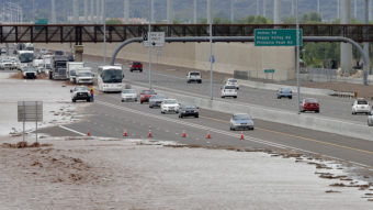 Flash-flood waters from the overrun Skunk Creek flood I-10 in northwestern Phoenix. Flooding from heavy rain forced authorities to close several major roads, including a portion of Interstate 17. Matt York/AP