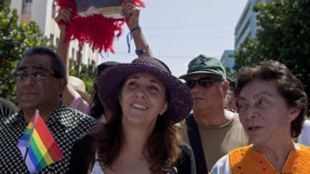 In what could be a first, Mariela Castro (center), daughter of Cuban President Raul Castro, voted against legislation in the country's parliament. In May, she marched in a parade for the International Day Against Homophobia in Havana. Franklin Reyes/AP
