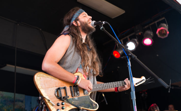 a man playing guitar onstage