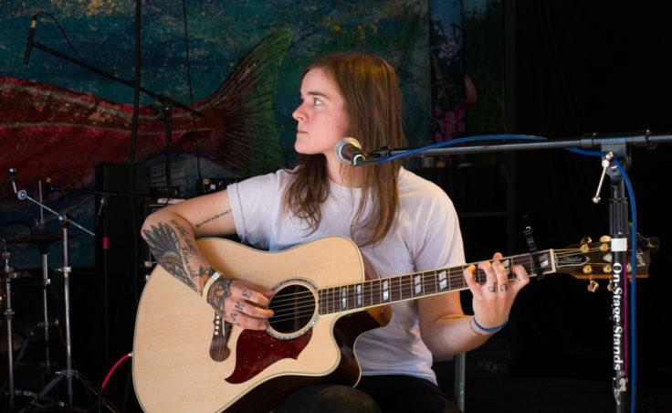 Liz Snyder with a guitar