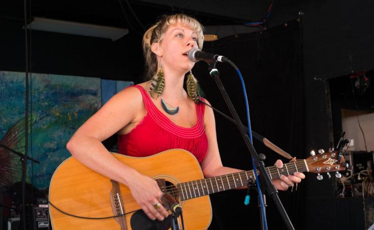 Sarah Moon plays guitar