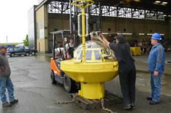 Bering Sea buoy receiving repairs. (Photo courtesy of Ellen Tyler/ Alaska Ocean Observing System)
