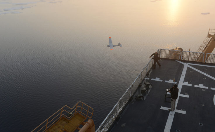 John Ferguson and Chris Thompson, Unmanned Aircraft System operators for AeroVironment, release a Puma All Environment UAS from the flight deck of the Coast Guard Cutter Healy during an exercise in the Arctic Aug. 18, 2014. The Coast Guard Research and Development Center and the National Oceanic and Atmospherc Administration evaluated the UAS for use in tracking a simulated oil spill during the exercise. (Coast Guard photo by Petty Officer 1st Class Shawn Eggert)