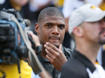 St. Louis Rams draft pick Michael Sam watches pregame festivities before the start of the South Dakota State-Missouri NCAA college football game on Saturday, in Columbia, Mo. Sam, the first openly gay player drafted by an NFL team, was released by the St. Louis Rams Saturday. L.G. Patterson/AP