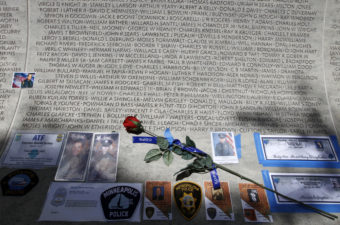 A rose is placed at the wall with the names of fallen police officers at the National Law Enforcement Officers Memorial in Washington during the National Police Week in 2013. Jose Luis Magana/AP