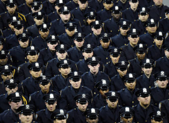 Cadets stand during the New York Police Department graduation ceremony at Madison Square Garden on Monday. Kevin Mazur/Getty Images