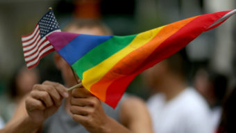 A protester waves an American flag and a rainbow flag in support of gay marriage in Miami in 2014. Secretary of State John Kerry announced Tuesday the appointment of a special envoy for the human rights of LGBT persons. Joe Raedle/Getty Images