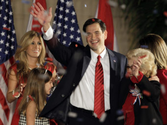 Marco Rubio celebrates on stage with his family in 2010 after winning his U.S. Senate seat in Florida when he was just 39 years old. Now, he's expected to embark on a run for president. (Photo by Alan Diaz/AP)
