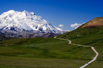 Down the valley towards Denali on with the park road wending its way. (Creative Commons photo by Nic McPhee)