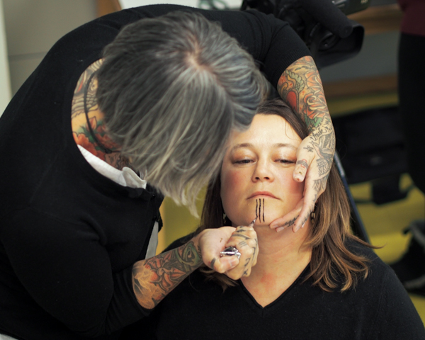 b5d43163845b9 Maya Sialuk Jacobsen of Greenland gives a henna tattoo to a friend's chin  during an event