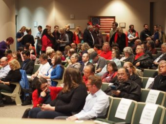 Members of the public line up to testify before the Anchorage Assembly on an anti-discrimination ordinance. Public testimony will continue Wednesday night, Sept. 16. (Photo by Zachariah Hughes/KSKA)
