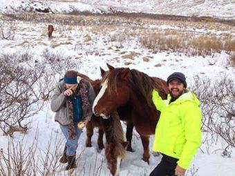 Keith Davis and a friend with Unalaska Island's wild horses in 2013. (Photo courtesy of Lynn Goodman)